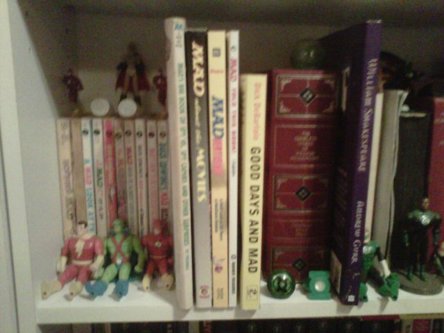 A murky pic of my MAD books, right next to my complete Shakespeare!