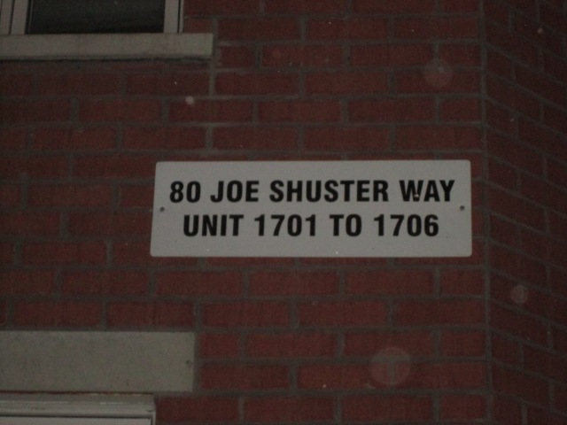 10 80 Joe Shuster Way Sign